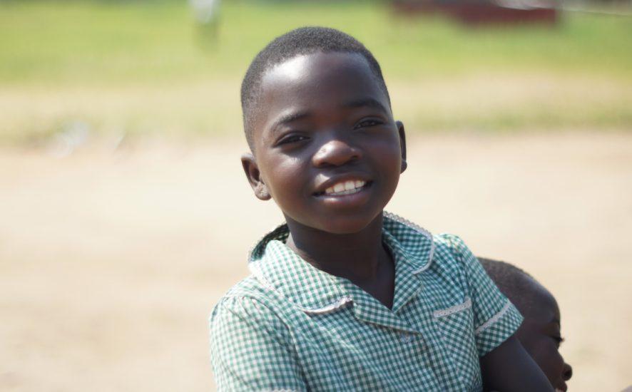 child in school uniform